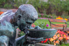 Sculpture near City Hall, Oslo Norway. Man drinking water is a famous sculpture near City Hall Oslo, Norway royalty free stock photography