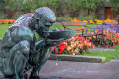 Sculpture near City Hall, Oslo Norway. Man drinking water is a famous sculpture near City Hall Oslo, Norway stock photography