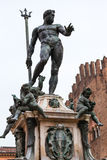 Sculpture of Neptune on fountain in Bologna. Travel to Italy - sculpture of Neptune on fountain of neptune in Bologna city royalty free stock photos