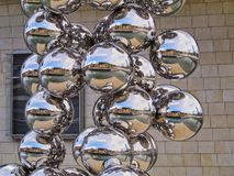 Sculpture next to The Guggenheim Museum Bilbao. Sculpture 'The Big Tree' consisting of 80 stainless steel balls with reflections by Anish Kapoor in front of The Royalty Free Stock Photos