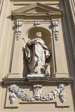 Sculpture in niche of facade church of the old Dominican convent Stock Image