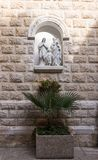 Sculpture in a niche in the St. Joseph`s Church wall in the old city of Nazareth in Israel. Nazareth, Israel, December 23, 2017 : Sculpture in a niche in the St stock photo