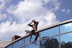 Sculpture Observer on the roof of contemporary building, Kiev, Ukraine. Royalty Free Stock Images