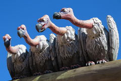 Free Sculpture Of Nasty Vultures Sitting On A Plank And Watch Stock Image - 55696651