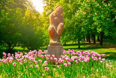 Sculpture Of Seated Woman In Letna Park On Sunny Summer Day With Pink Tulips, Prague, Czech Republic Royalty Free Stock Photos