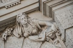 Free Sculpture Of Strange And Awkward People Of Renaissance Era As Support For Building Facade In Vienna Downtown, Austria, Details, Stock Photo - 156034420