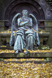 Sculpture of an old weathered arch angel Stock Photography