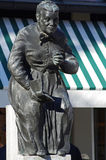 Sculpture of an old woman reading a book Royalty Free Stock Images