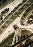 Sculpture On Side Of Notre Dam Stock Photo