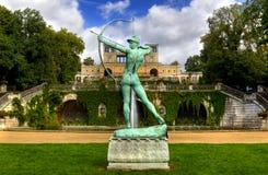Sculpture and the Orangery Palace (Orangerieschloss) in Park Sanssouci in Potsdam Royalty Free Stock Photos