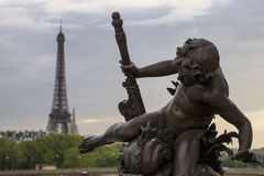 Sculpture in Paris with the Eiffel Tower in the background. Stock Image