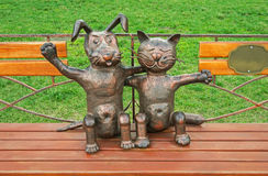 Sculpture pets. Humorous sculpture pets that embrace and symbolize love and reconciliation Royalty Free Stock Image