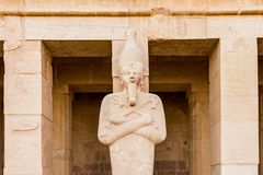 A sculpture of Pharaoh at the Mortuary temple of Hatshepsut near the Egyptian city of Luxor. Built for the Eighteenth Dynasty pharaoh Hatshepsut, it is located stock photo