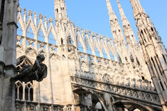 Sculpture and pinnacles at Italian Duomo di Milano Stock Images