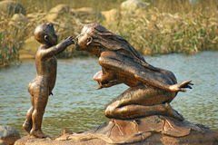 Sculpture: play mother and son. Bronze sculpture: mother and son game, affection, warmth, a mother's love Stock Image