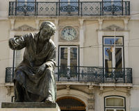 Sculpture of a poet. Bronze sculpture in memory of Antonio Ribeiro, poet from Evora in the Chiado Square, Lisbon, Portugal stock image