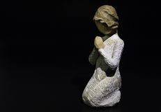 Sculpture prayer doll isolated on black background Royalty Free Stock Photo