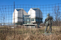 Sculpture of prisoner in front of Museum of Contemporary Art in Belgrade. Landscape of the beautiful modern building of the Museum of Contemporary Art in Royalty Free Stock Images