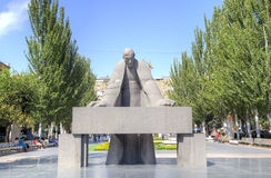 Sculpture of the prominent armenian architect Alexander Tamanyan bent over drawings. Royalty Free Stock Image