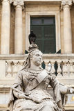 Sculpture of Queen Victoria with pigeon in capital of Malta- Val. Sculpture of Queen Victoria with pigeon in front of the building of library on Republic Square Royalty Free Stock Image