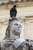 Sculpture of Queen Victoria with pigeon in capital of Malta- Val. Sculpture of Queen Victoria with pigeon in front of the building of library on Republic Square Stock Image