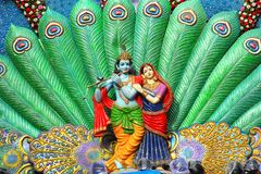 Sculpture of Radha Krishna and peacock feather during Dahi Handi festival royalty free stock images