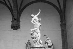 Sculpture The of Sabine Women, made by sculptor Giambologna. Loggia dei Lanzi on the Piazza della Signoria in Florence, Italy. Black and white photo stock image