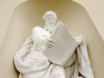 Sculpture of reading Man. Big Monument of ancient Man reading a Book Stock Images