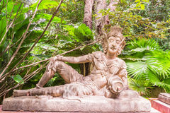Sculpture of reclining angel in botanic garden Royalty Free Stock Image