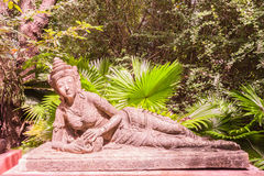 Sculpture of reclining fairy in botanic garden Royalty Free Stock Photo