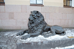 Sculpture of a reclining lion. Royalty Free Stock Photo