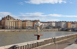 Sculpture and the river Rhone. Lyon, France Royalty Free Stock Photography