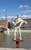 Sculpture and the river Rhone. Lyon, France Stock Photography
