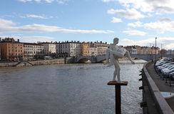 Sculpture and the river Rhone. Lyon, France Stock Photo