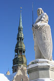 Sculpture of Roland. And  St. Peter's Cathedral (Town Hall square, Riga, Latvia).  is an old symbol of judicial power, freedom and independence of many European Royalty Free Stock Photo