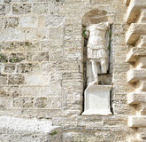 Sculpture Roman centurion. In the wall of the city of Ibiza Stock Photography