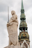 Sculpture of Ronald and St. Peter's Cathedral in Riga Stock Photography