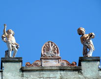 Sculptures on the top of building as decoration Stock Image
