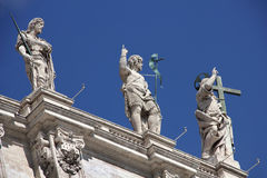 Sculpture on the roof of the St. Peter's Basilica Stock Photo