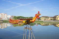 Sculpture of a rooster, flying over the Thu Bon river. Hoi An, Vietnam Royalty Free Stock Photo