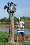 Sculpture of a Russian Bogatyr with Zmey Gorynych Stock Image
