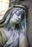 Sculpture of a sad woman Stock Photos