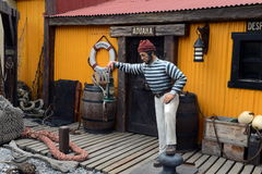 Sculpture of a sailor on the street of Ushuaia. Royalty Free Stock Images