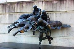 Sculpture of sailors in War Memorial in Australia. Sculpture of sailors fighting for their lives in the boar in War Memorial in Canberra, Australia Royalty Free Stock Photography