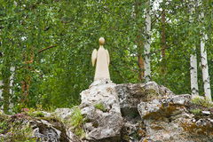 Sculpture the Saint angel on a rock Royalty Free Stock Images