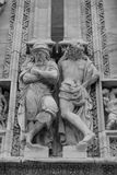 Details of the facade of the Duomo of Milan. Black and white photo of the facade sculpture of saints of Milan Cathedral royalty free stock photos