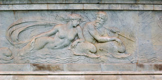 Sculpture of the sea God Poseidon. And a young woman embossed in marble Stock Photos