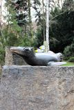 Prague, Czech Republic, January 2015. Sculpture of a seal in a zoological garden on a stone pedestal. stock photography