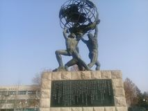 Sculpture of several naked men holding world in hands. Chuncheon, Seoul South Korea, January 21, 2018: Sculpture of several naked men holding world in hands Stock Photos