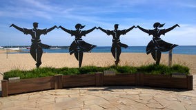 Sculpture showing the Sardana in Blanes, Spain Royalty Free Stock Images